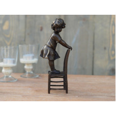 Girl standing on a chair
